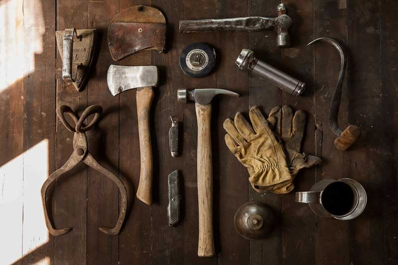 Tools laying on a table - community association management